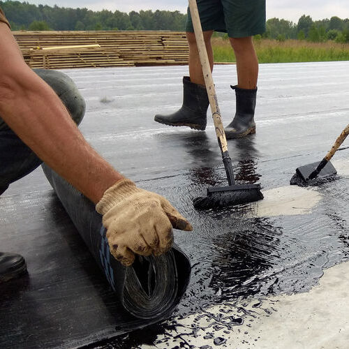 Roofers Install Modified Bitumen Roof.