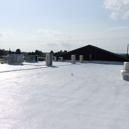 A Roof Sprayed With SPF Spray Foam Roofing